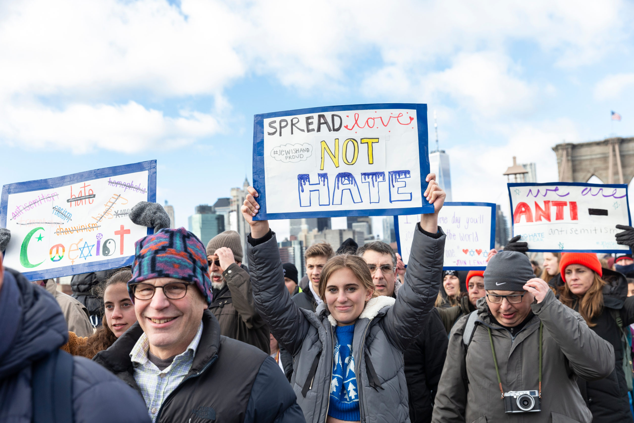Thousands of people participate in No Hate, No Fear Jewish Solidarity March in response to anti-semitic attacks in and around city across Brooklyn Bridge. (Lev Radin/Shutterstock)